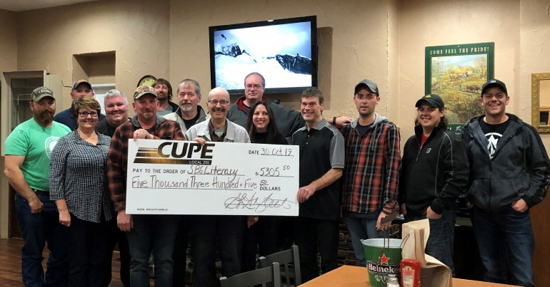 Image of group of people from CUPE 255 holding a giant cheque