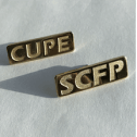 Gold coloured rectangular pins, one that says CUPE, one that says SCFP