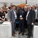A group of people including Mark Hancock, Charles Fleury and Jagmeet Singh standing in front of a backdrop that says CUPE/SCFP
