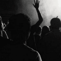 Black and white image of a crowd of people from the back